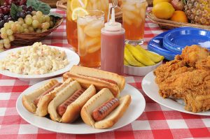 A picnic table loaded with summer foods